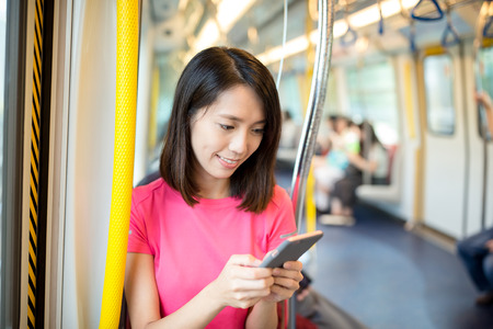 compartment: Woman use of cell phone inside train compartment