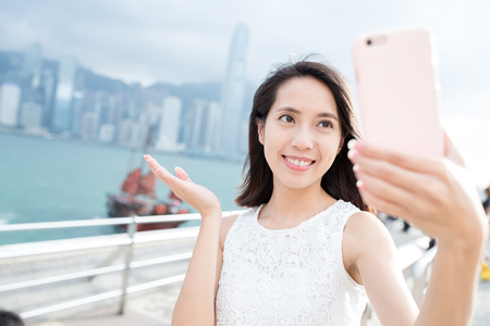 self image: Woman taking self image at Victoria Harbor