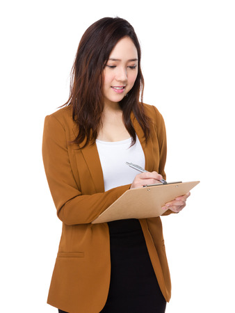 take a note: Buisnesswoman take note on clipboard Stock Photo