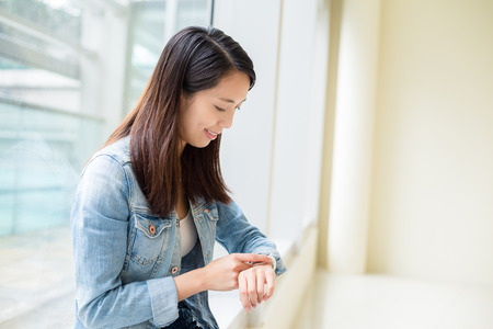 Woman using wearable smart watch