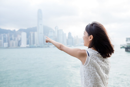 hong kong island: Woman finger point to the Hong Kong Island Stock Photo