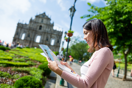 Woman looking for location in Macau city Stock Photo