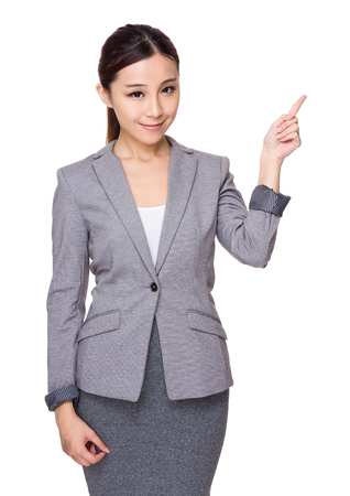 proclaim: Asian Young businesswoman with finger point up Stock Photo
