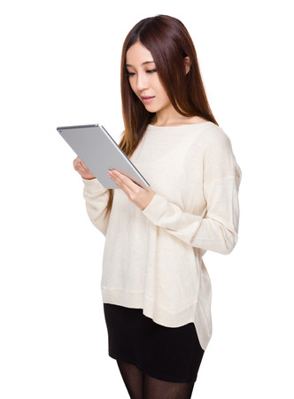 white sleeve: Asian woman read on the tablet pc