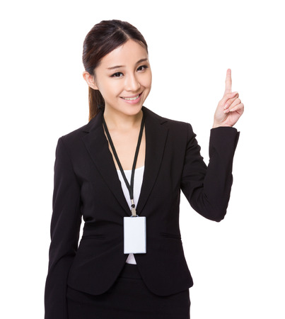 name badge: Asian young businesswoman hold wih name badge and finger point up