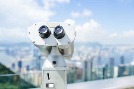 Tourist binocular with background of Hong Kong city