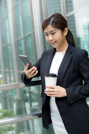 building planners: Business woman use of mobile phone Stock Photo