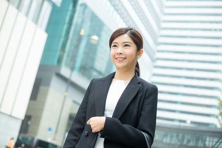 building planners: Business woman walking at outdoor