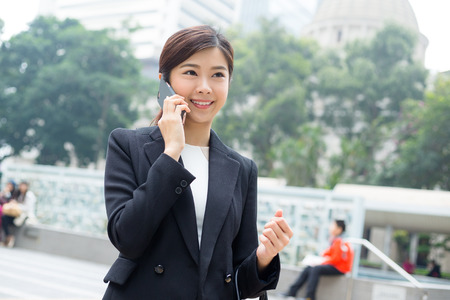 far away look: Business woman talk to mobile phone