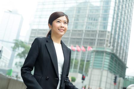 far away look: Asian bsuiness woman Stock Photo