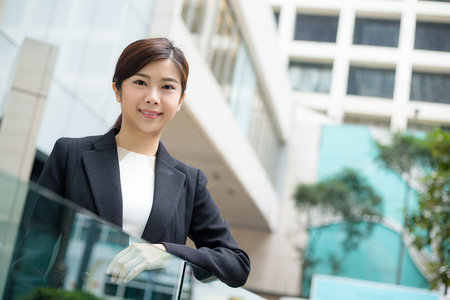 building planners: Businesswoman standing at outdoor Stock Photo