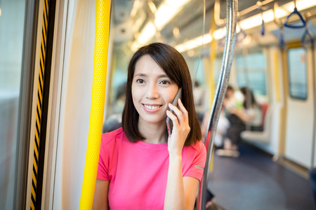 compartment: Woman talk to phone inside train compartment Stock Photo