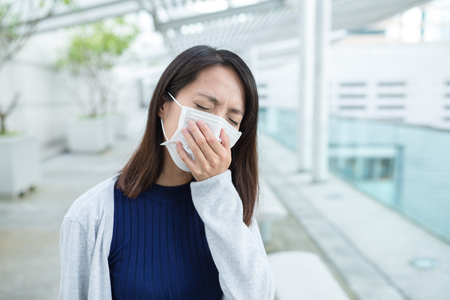 transmissible: Woman feeling unwell at outdoor Stock Photo