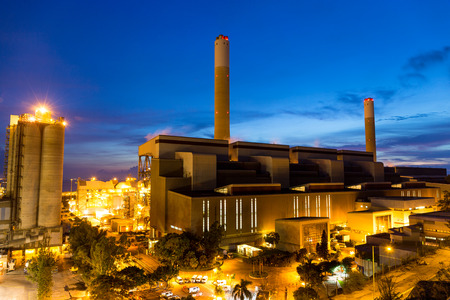 tall chimney: Coal Power plant at dusk