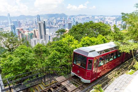 Victoria Peak Tram en Hong Kong skyline van de stad Stockfoto