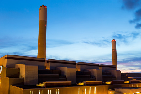 cement chimney: Cement plant at night Stock Photo