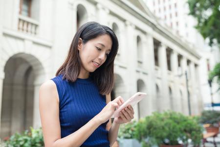 woman on phone: Woman using smart phone Stock Photo