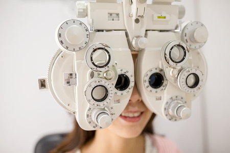 Woman having optometry machine vision