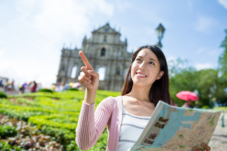 macao: Woman travel in Macao with paper map