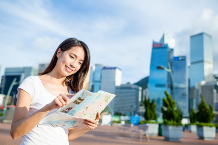 woman searching: Woman searching the location on city map