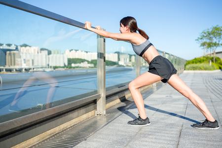 warm up exercise: Woman doing warm up exercise Stock Photo