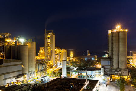 tall chimney: Cement factory at night