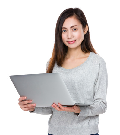 sweatsuit: Young woman use of the noteboook computer