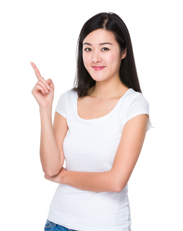 Young woman with finger point up Stock Photo