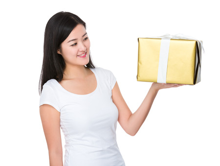 Young Woman looking at the gift box