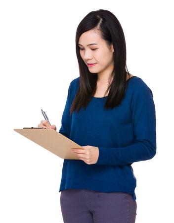 sweatsuit: Woman take note on clipboard