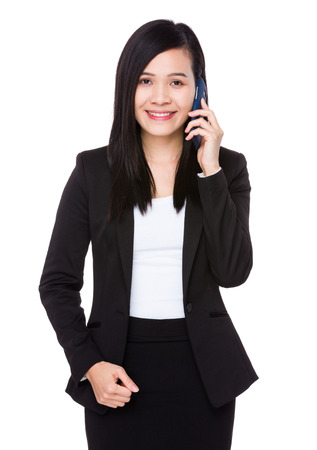 hear business call: Asian Businesswoman chat on mobile phone