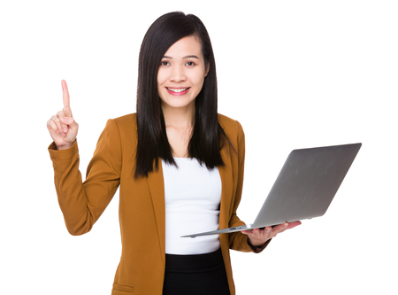 Young Businesswoman hold with notebook computer and finger point up Stock Photo