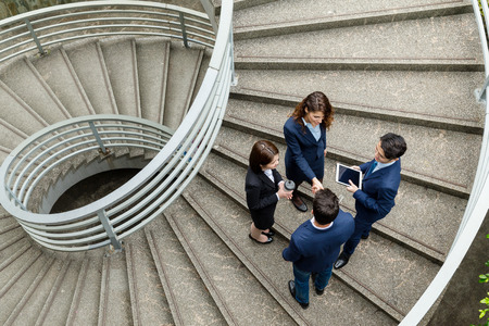 Top view of business people standing at the steps Banque d'images