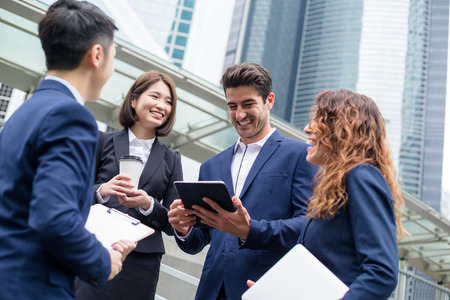 team leadership: Business people working outside office