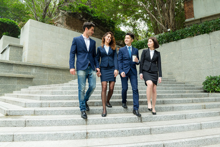 buisness woman: Group of business people walking down stair in Hong Kong central business district