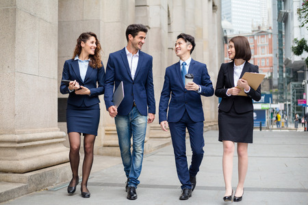 Group of business team walking at street