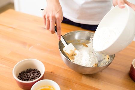 batter: Adding flour inside batter Stock Photo