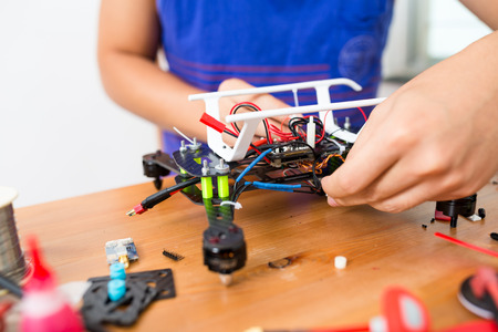 Man connecting the electronic parts on drone