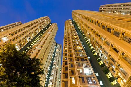 overpopulated: Low angle view apartment building