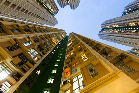 overpopulated: Apartment Building from low angle Stock Photo