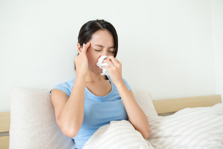 runny: Woman suffer form headahce and runny nose