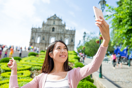 saint pauls cathedral: Young Woman taking selfie with Saint Pauls Cathedral in Macau