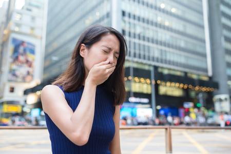 Woman sneeze outside