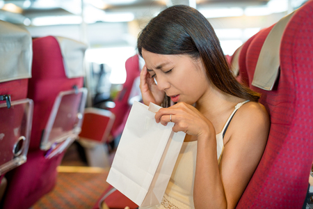 Woman feeling unwell and travel on boat