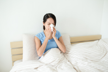 runny: Woman runny nose Stock Photo