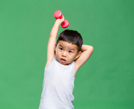 weighting: Little boy weighting up dumbbells