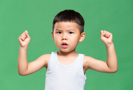 stronger: Little boy making a stronger pose Stock Photo