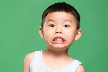 grimace: Little boy showing grimace