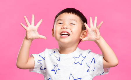 grimace: Excited little boy showing grimace