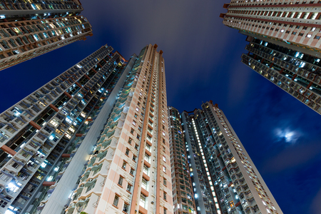 overpopulated: Residential building from low angle at night